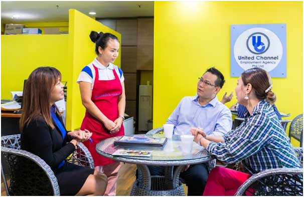 a transfer maid being interviewed in an employment agency office