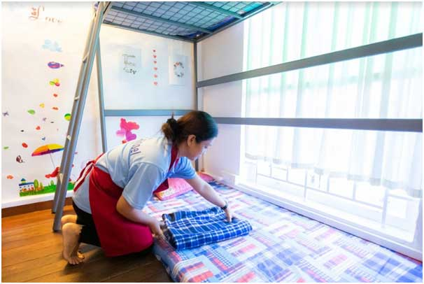 a transfer maid demonstrating her skill in doing household chores