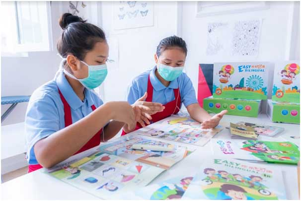 maids are learning to communicate with their employer using books