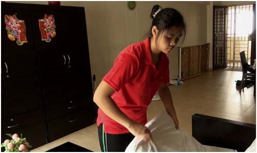 A maid going about her daily household chores