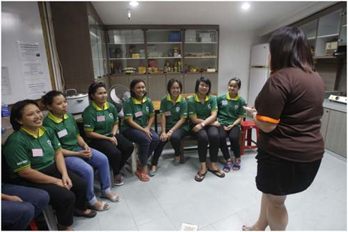 Some maids undergoing training and briefing