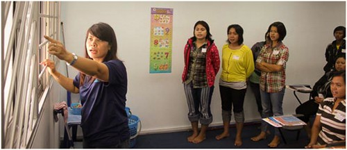 Maids in Singapore attending some lessons